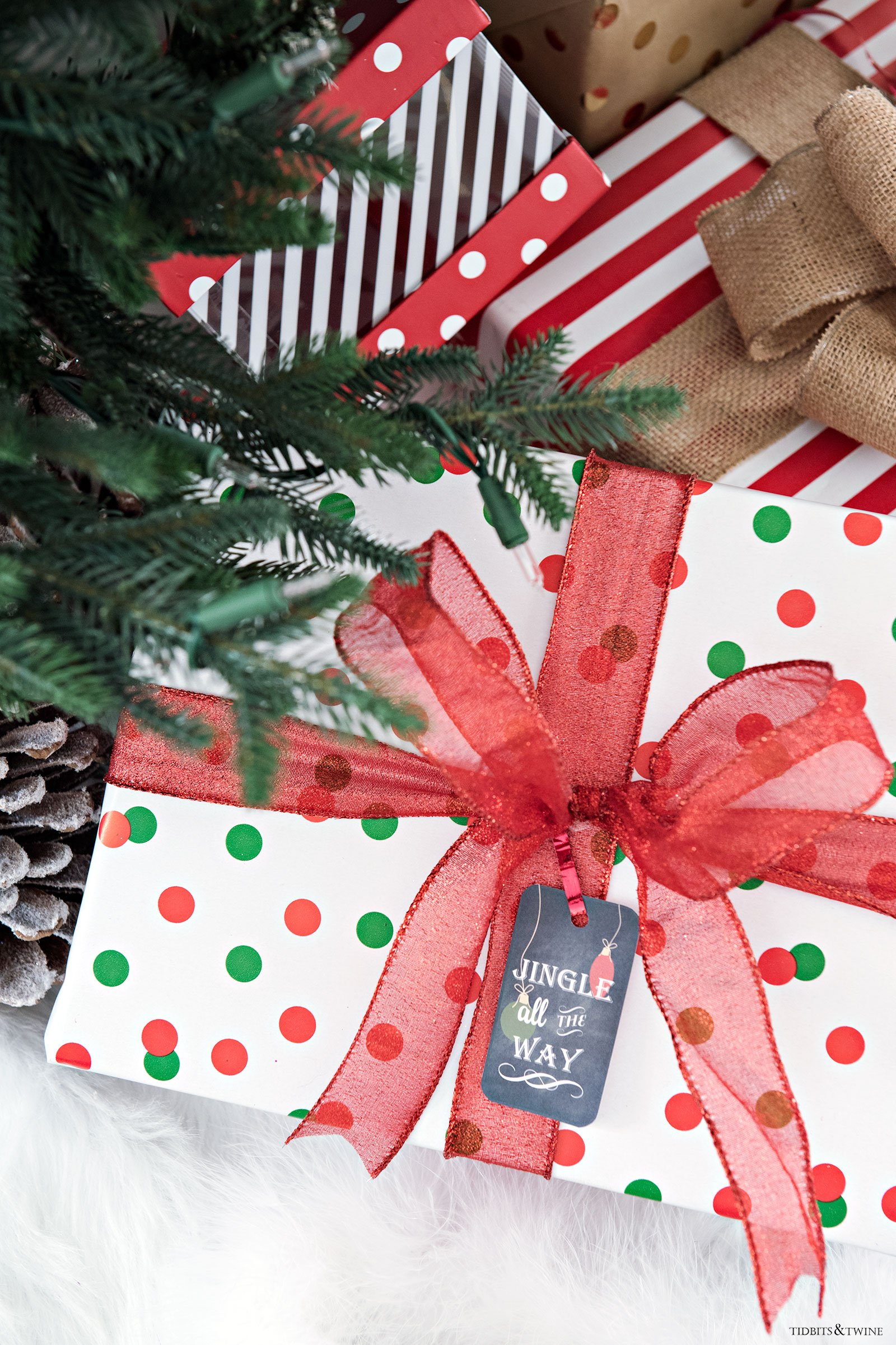 Red and white wrapped Christmas packages with FREE downloadable Christmas tags