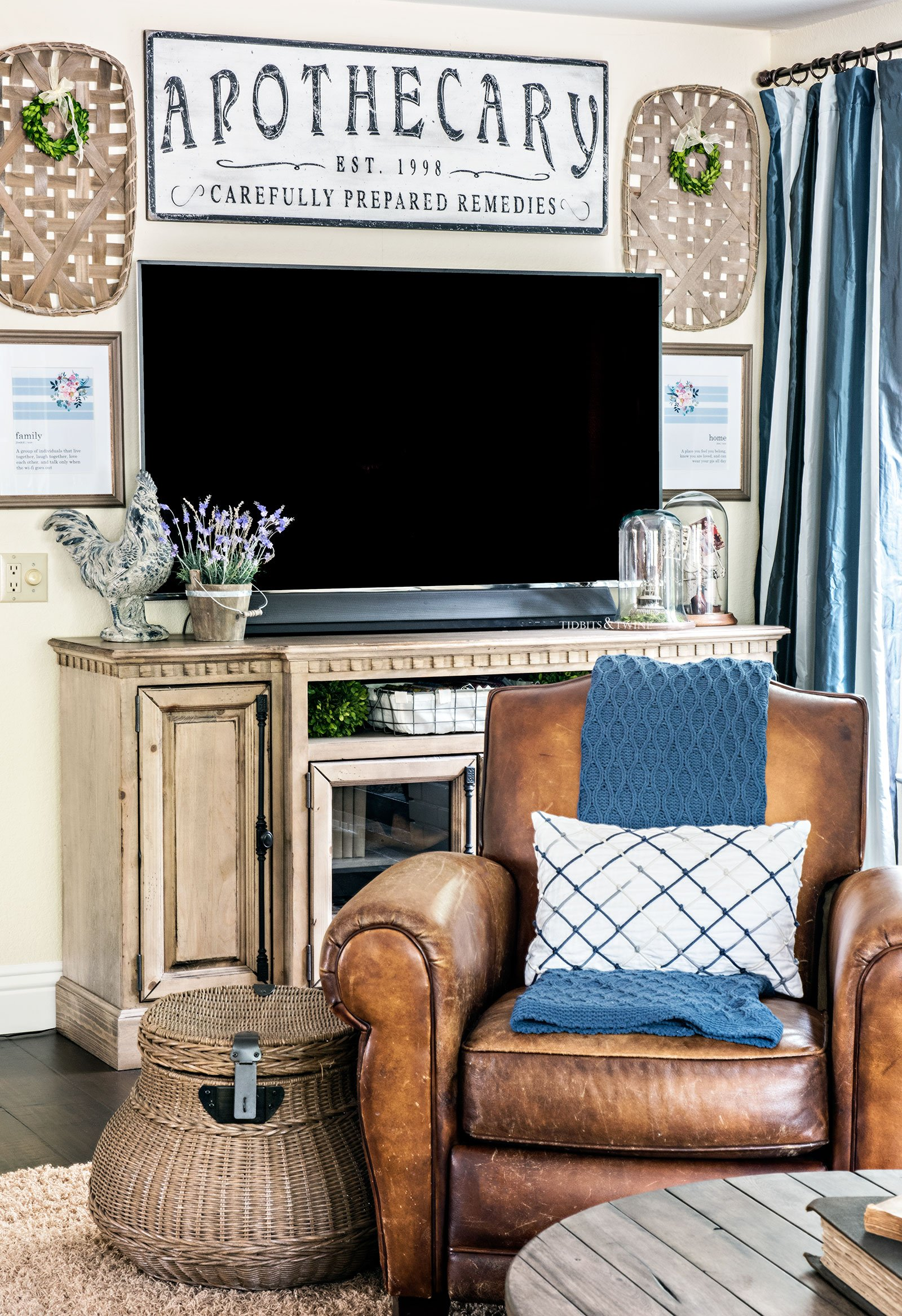 French Farmhouse Gallery Wall around a TV with leather reclining chair