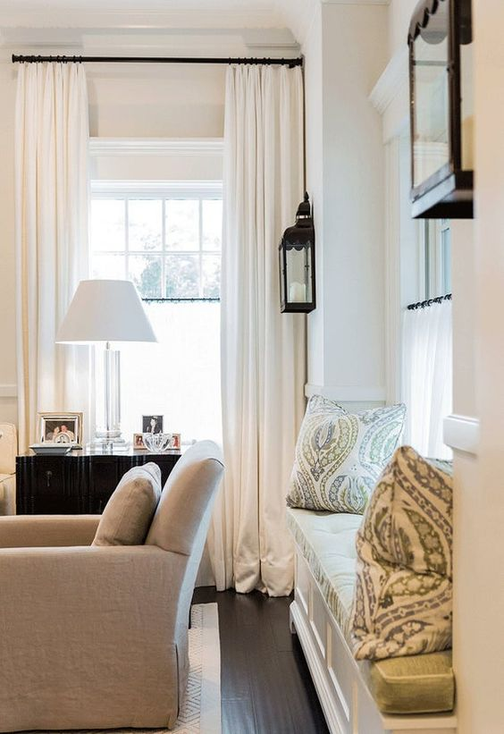 Family room with window seat and white curtains