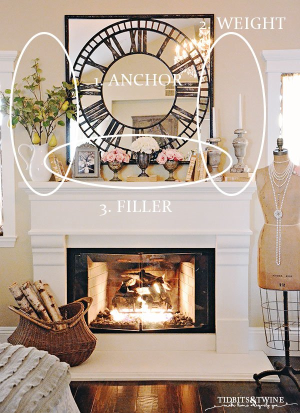 White fireplace mantel with mirror clock above candlesticks and books