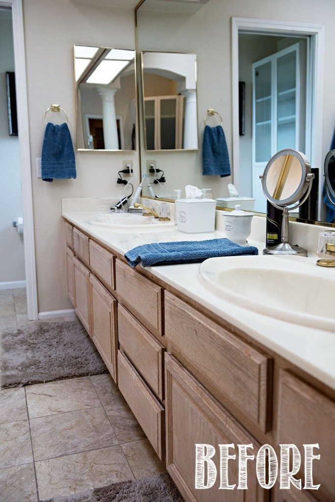 cultured marble bathroom vanity with oak cabinets and gold fixtures