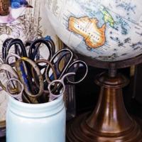 Vignette with scissor collection in mason jar and globe. #vignette
