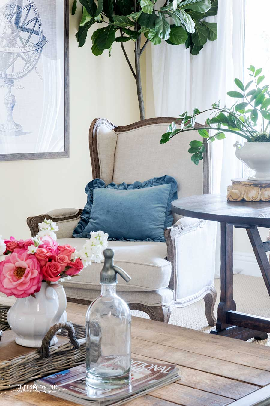 French wingback chair with blue ruffle pillow