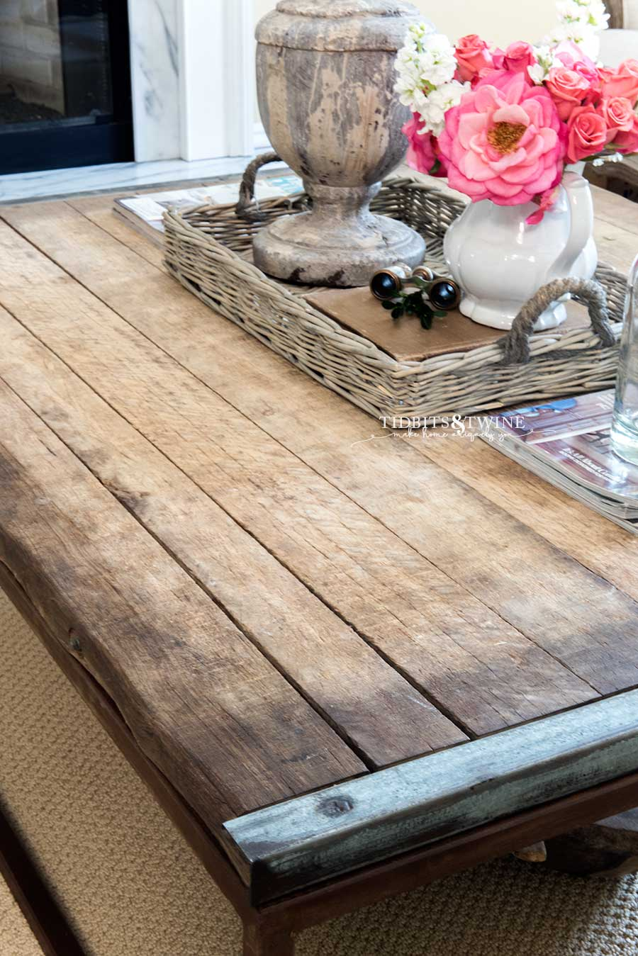 Industrial coffee table with basket centerpiece and pink roses