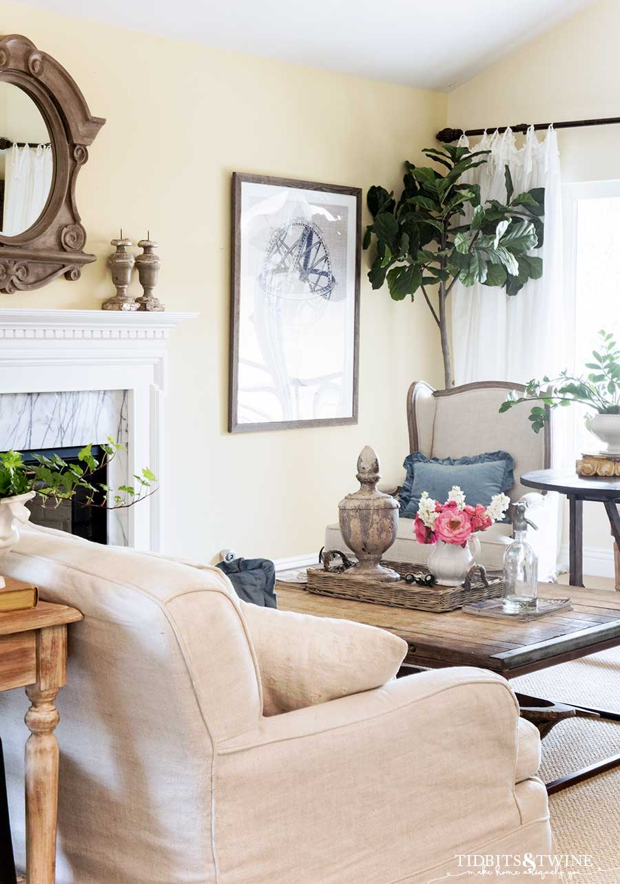 French wingback chairs and slipcovered sofa in living room