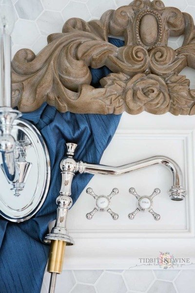 Elegant French marble master bathroom with blue, white and aged wood