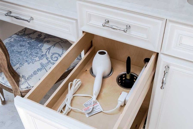 Bathroom vanity pullout hair dryer holder