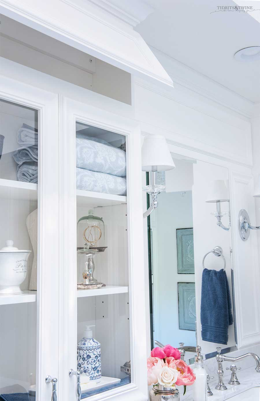 Hidden cabinet storage on white bathroom vanity