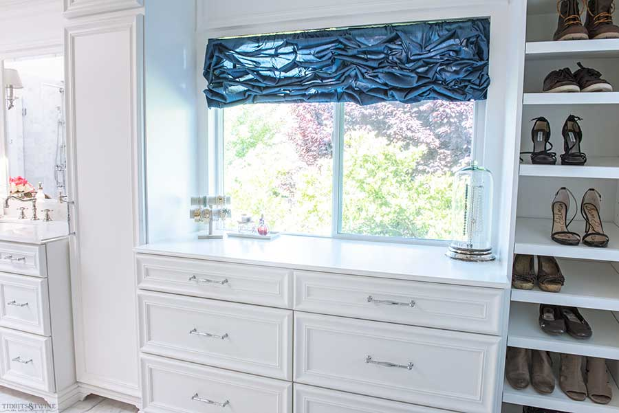 French elegant master bathroom with dressing area cabinets and shoe storage