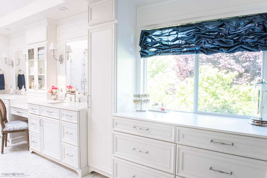 French elegant master bathroom with white double sink vanity connected to dressing area