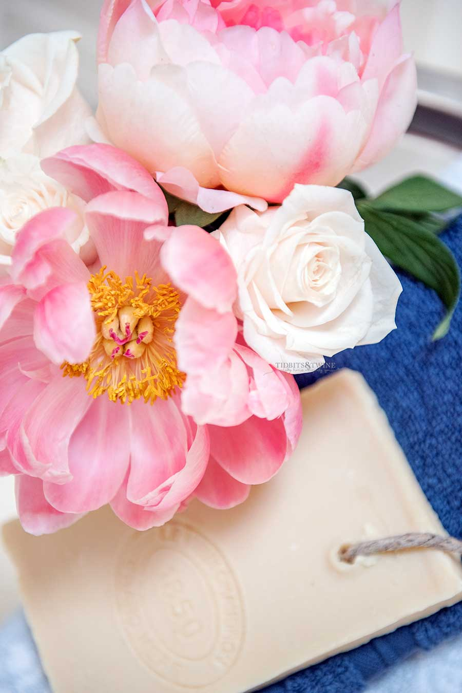 Pink peonies and white roses in a French elegant master bathroom