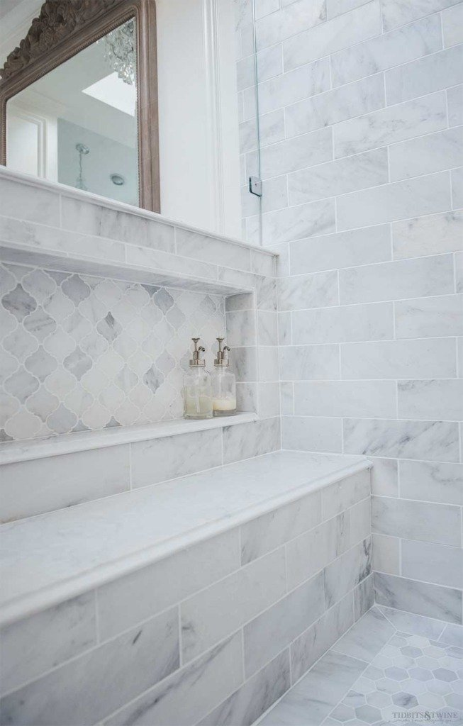 Oversized shower niche in pony wall in carrara marble with quartz bench seat