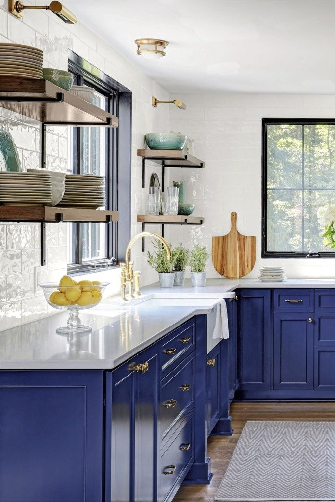 Contemporary kitchen with classic blue cabinets gold hardware and white countertop