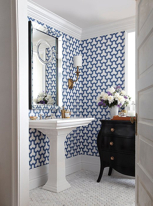Bathroom with pedestal sink and blue and white wallpaper