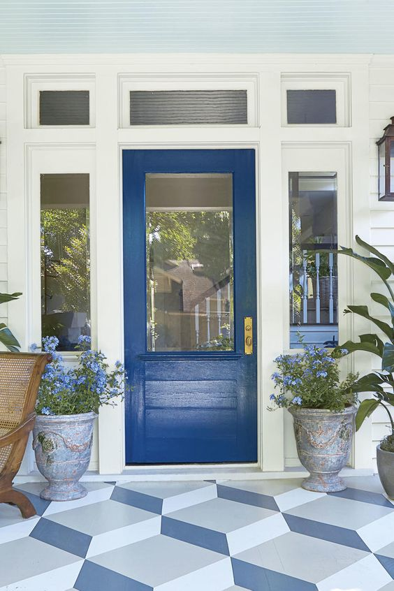 Classic blue front door with light blue beadboard ceiling