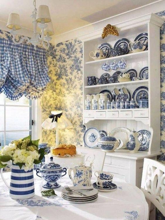 French country kitchen with classic blue checkered curtains and toile wallpaper