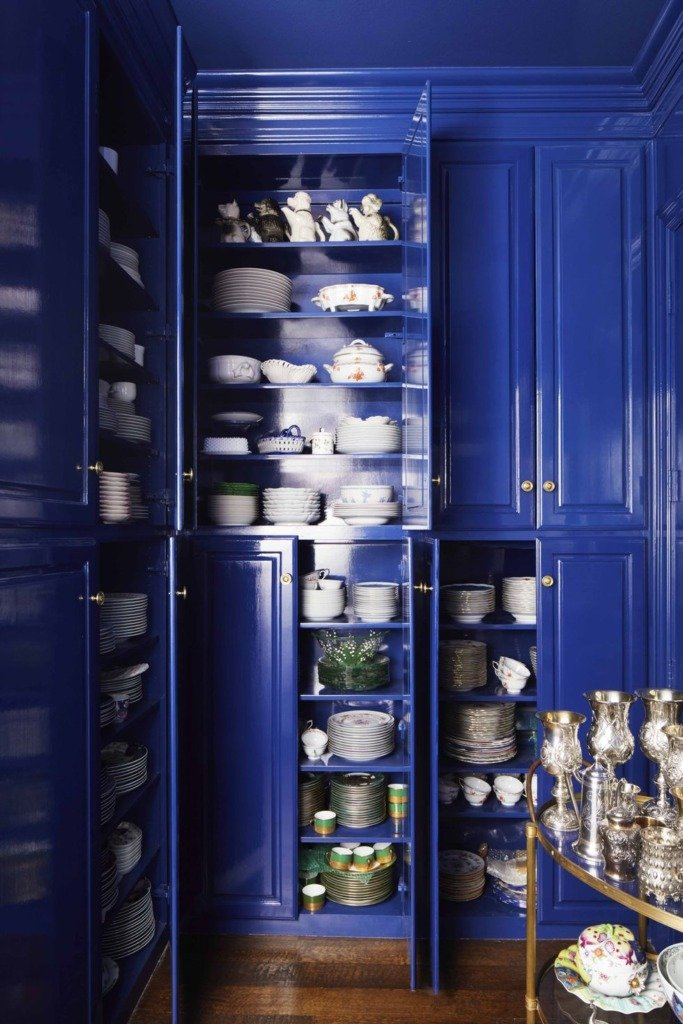 Farrow and Ball glossy blue cabinets in butlers pantry with white dishes