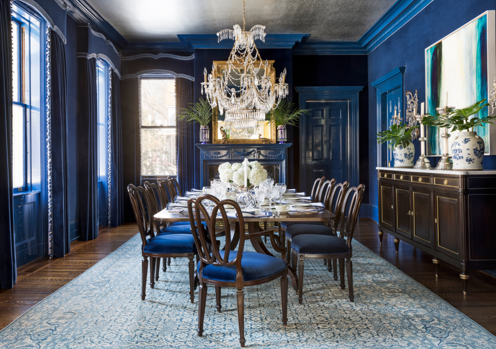 classic blue traditional dining room with blue walls and chairs