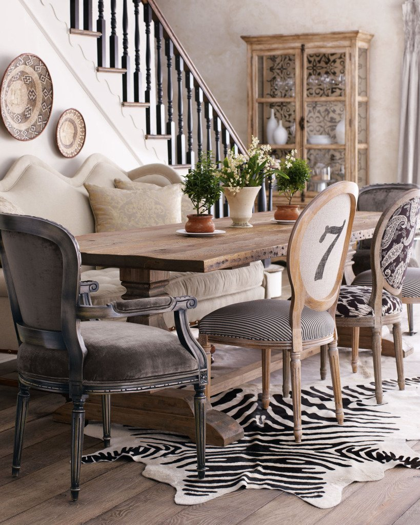 Mismatched dining chairs with trestle table and zebra rug
