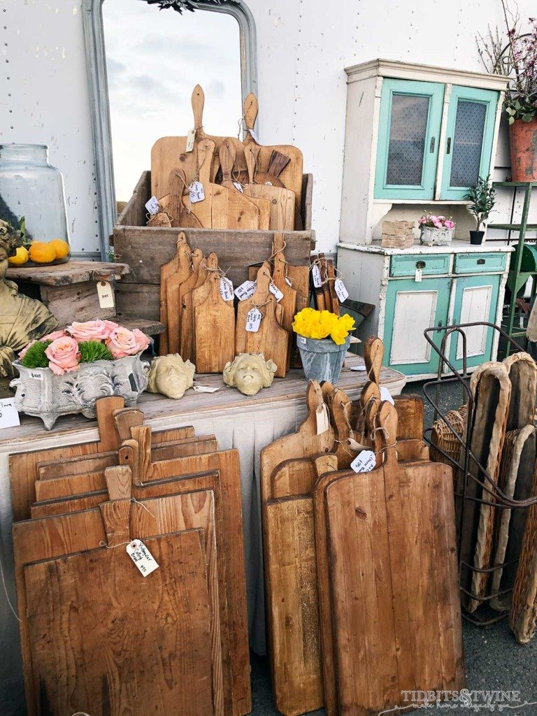 Atelier de Campagne booth display with vintage bread boards