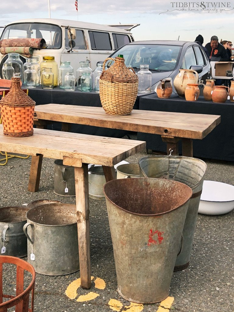 Vintage European demijohns and harvest buckets