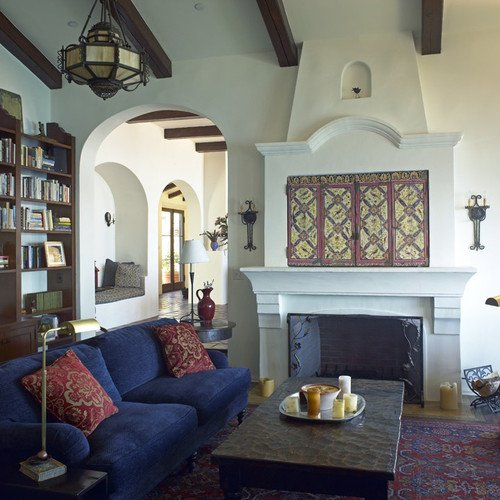 TV above fireplace with decorative doors