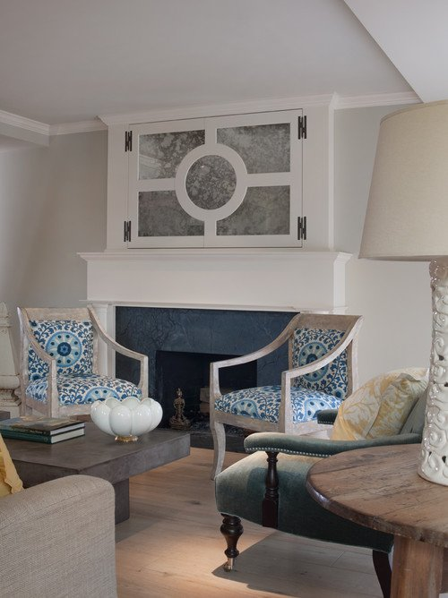 TV above fireplace with cabinet doors