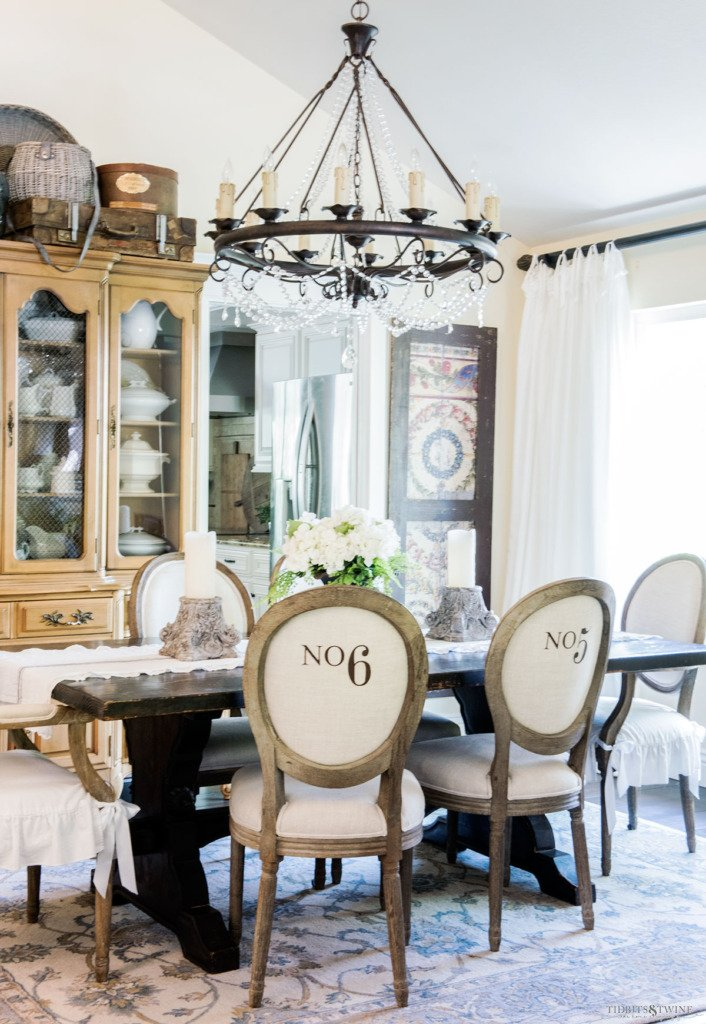 French dining room with numbered chairs and crystal chandelier