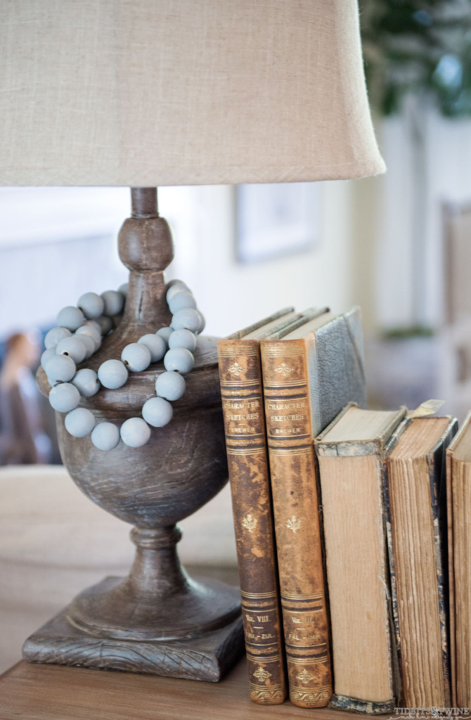 How to use chalk paint to create a faux aged wood look!  Paired with milk painted beads and deckled edge books