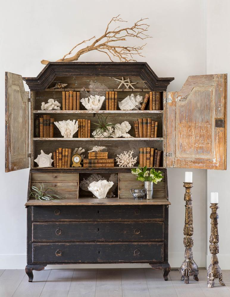 Tidbits and Twine - Brooke Giannetti black antique cabinet with books