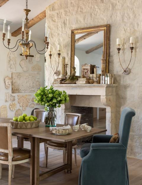 Brooke Giannetti French country Dining Room and Fireplace flanked by sconces