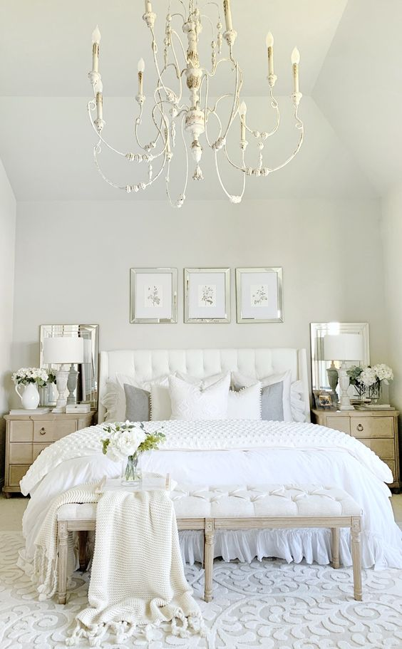 Master bedroom with white french chandelier