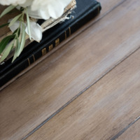 Closeup of French country coffee table top painted to look like wood