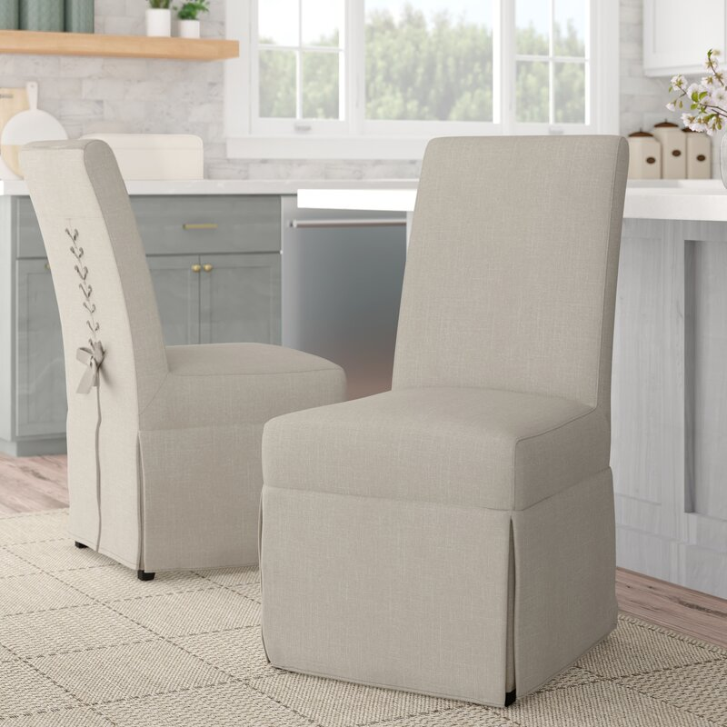 Beige slipcovered parsons chair with laceup back from Birch Lane