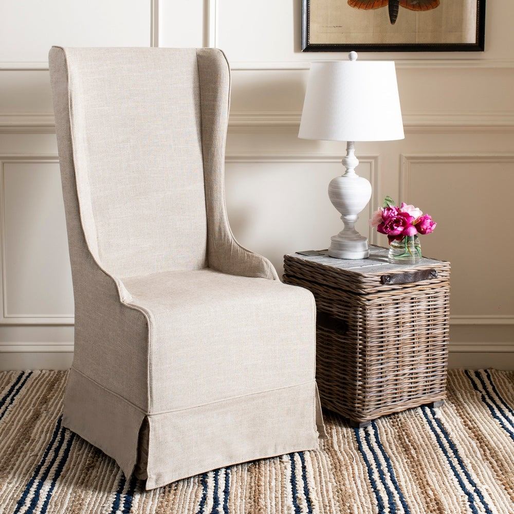 Beige wingback slipcovered dining chair from Joss & Main