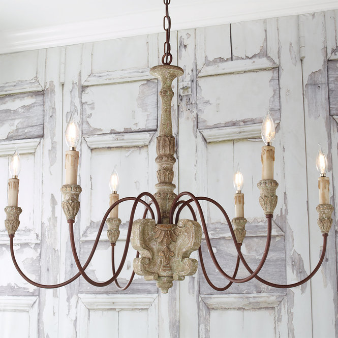 Rustic French chandelier with six lights and carved wood column and wax candles