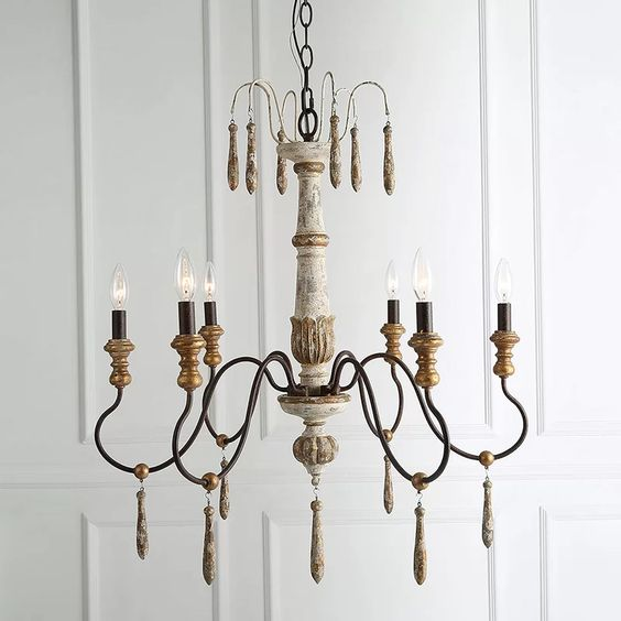 Closeup image of a French country chandelier with 6 lights and gold leafing