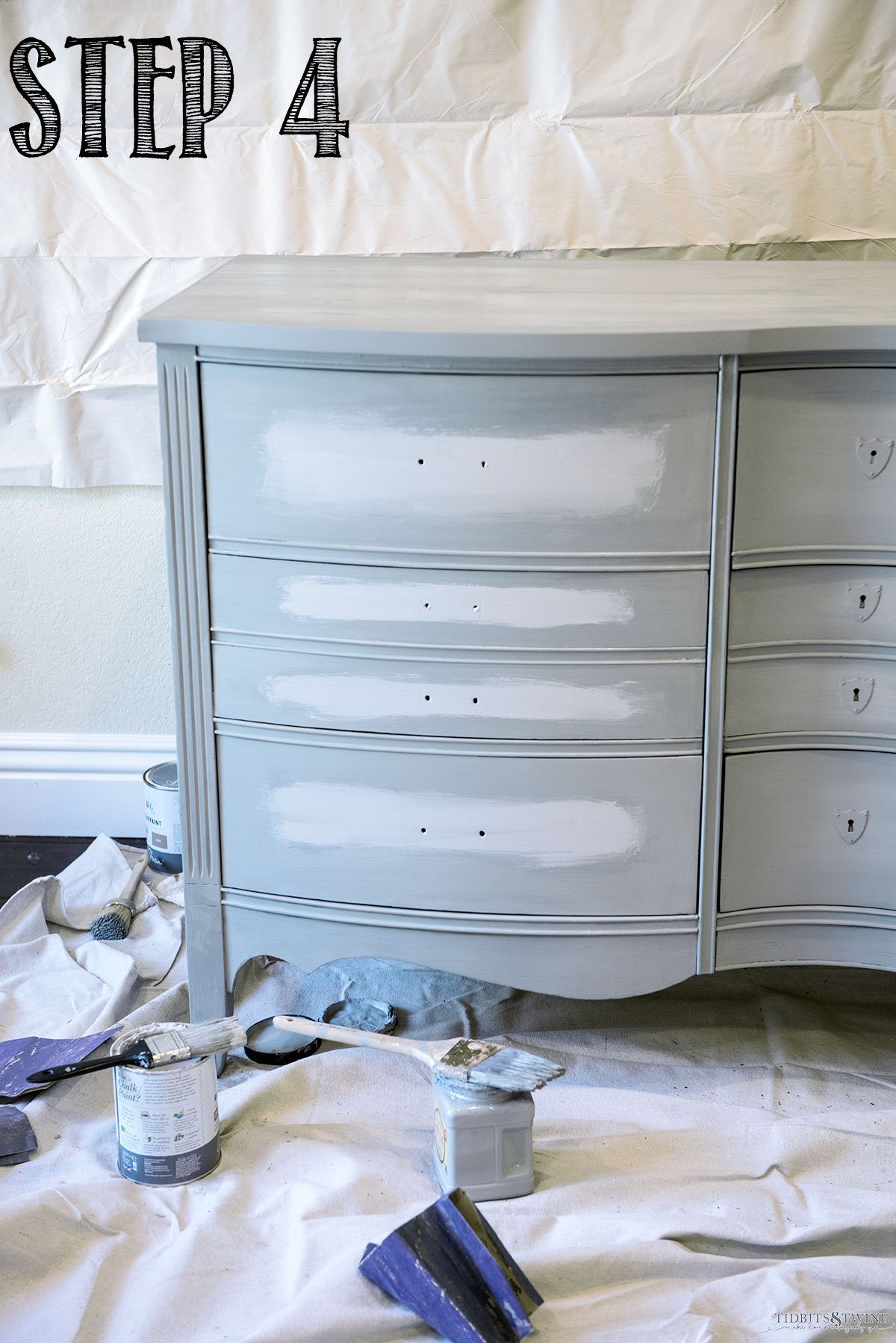 Antique dresser with manatee gray and chicago grey in the center of drawers