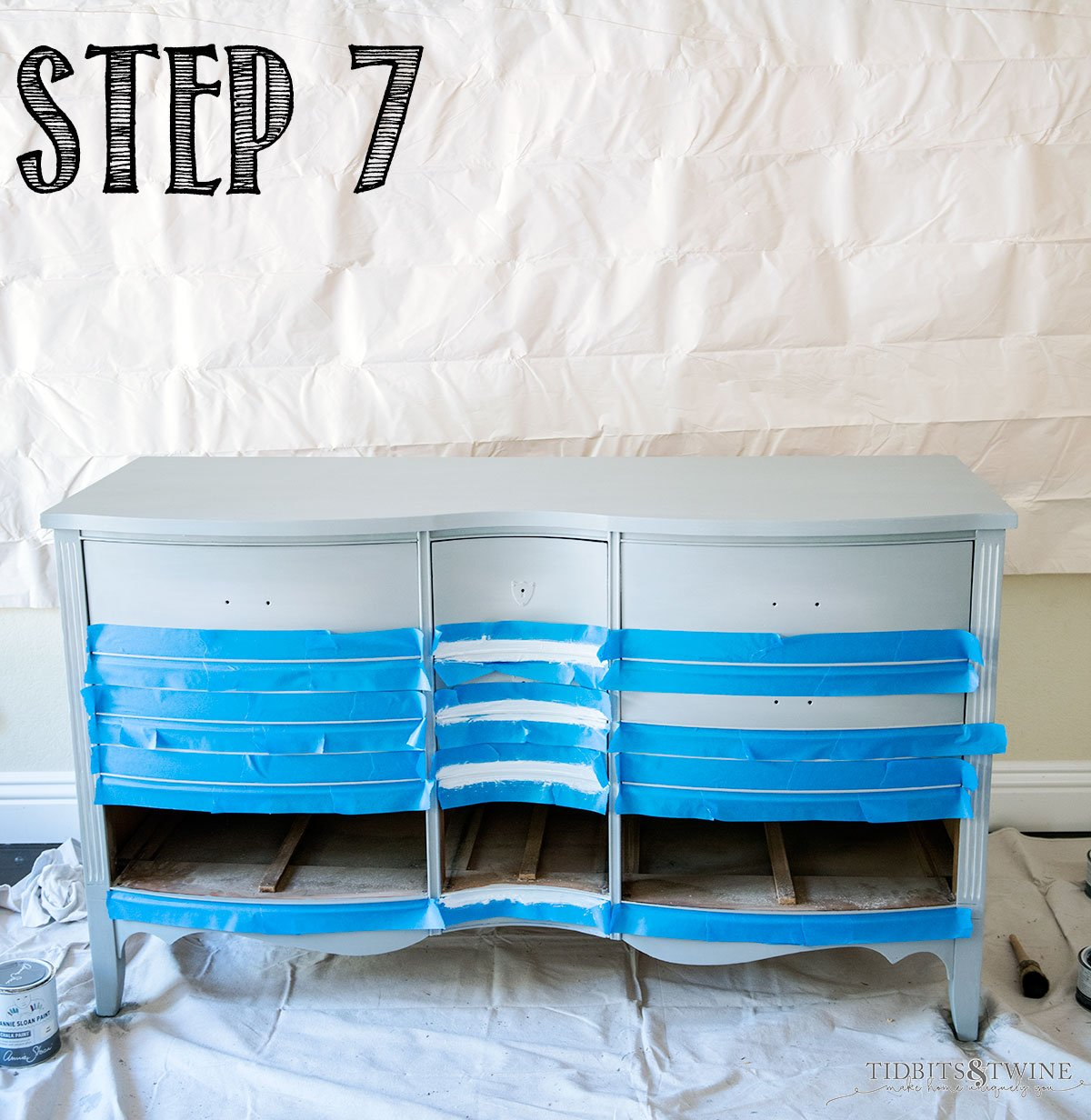 Antique dresser painted gray blue and taped off to paint white highlights