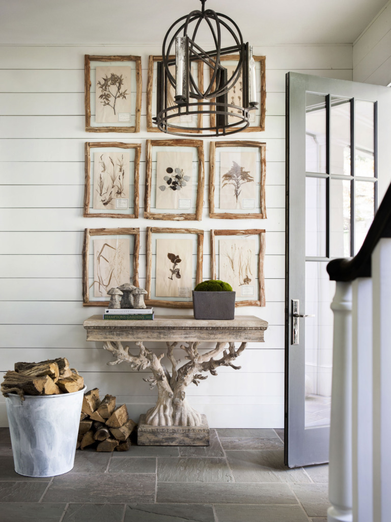 Foyer with rustic tree console table and branch framed gallery wall
