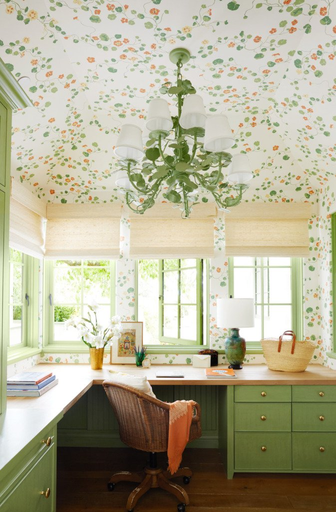 green built-in corner desk home office with green and orange floral wallpaper