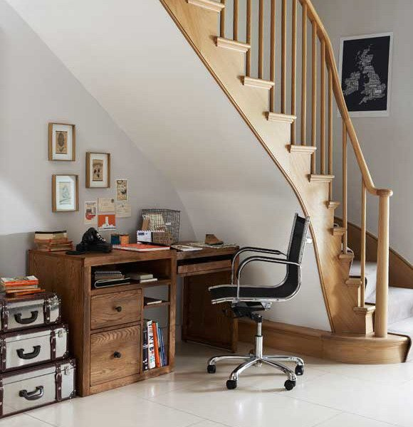 home office desk tucked underneath the stairs
