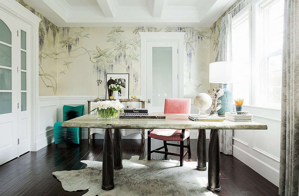 Home office in a dining room with wisteria wallpaper and cowhide rug