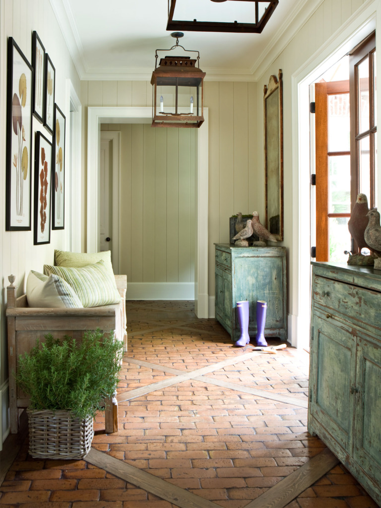 Entryway with brick floors blue vintage cabinets and hanging lantern