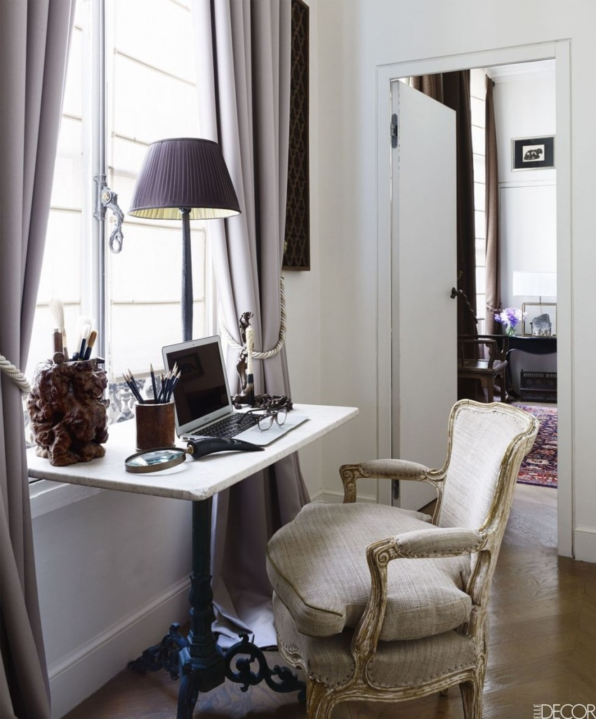 beautiful French parisian home office with table underneath a window and french style chair