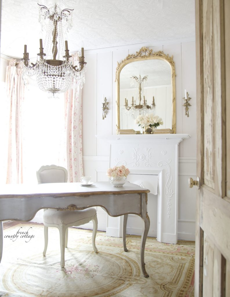 French romantic home office with gray desk fireplace and crystal chandelier
