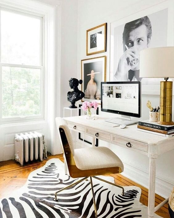 french contemporary home office with gallery wall above desk and zebra rug