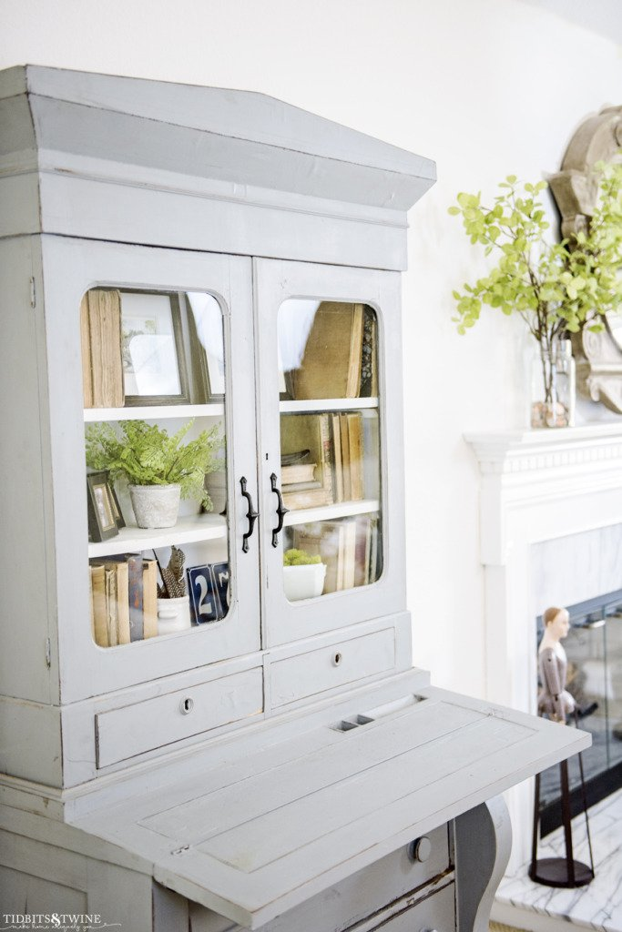Blue french hutch with styled shelves with flip down desk