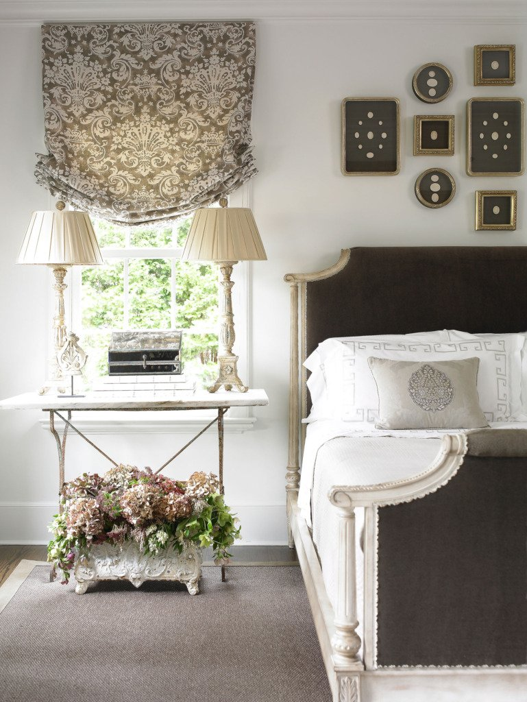 french master bedroom with brown velvet bed and table as a nightstand