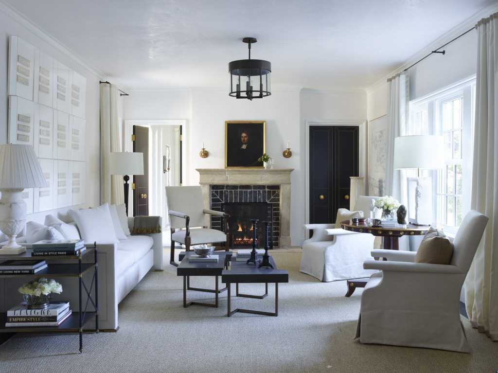 formal living room with french fireplace and slipcovered furniture